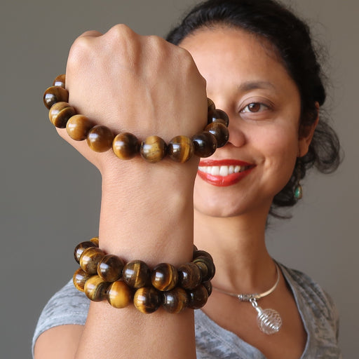 sheila of satin crystals wearing golden brown tigers eye round stretch bracelets