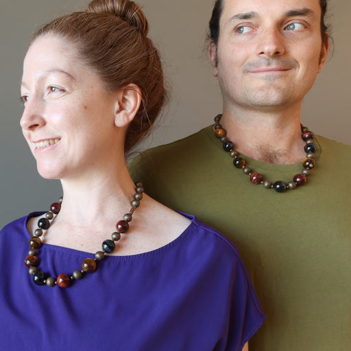 kendrick and jamie of satin crystals wearing golden, blue and red tigers eye on antiqued beaded necklace