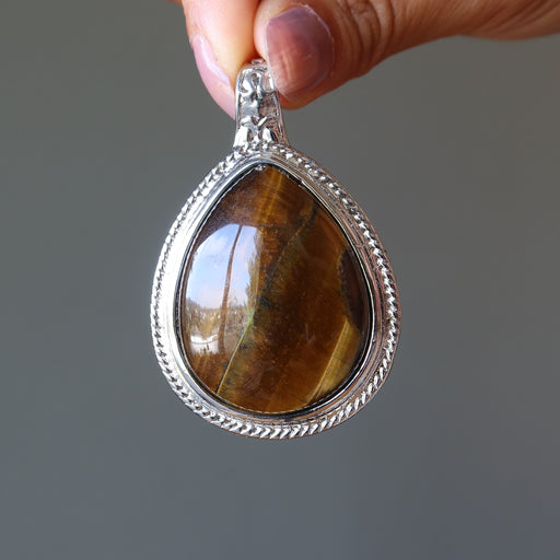 golden brown tigers eye teardrop in silver pendant in satin crystals gift box