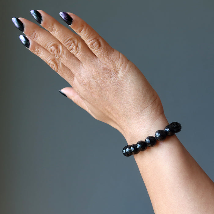 hand wearing faceted black tourmaline bracelet