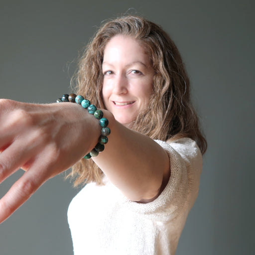 jamie of satin crystals wearing blue turquoise beaded bracelet