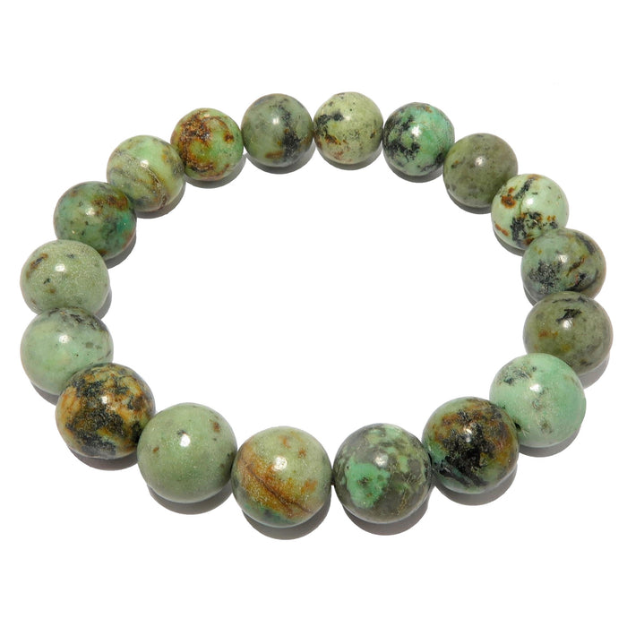 green jasper stone with yellow and black patterns polished into round beads and strung on a bracelet
