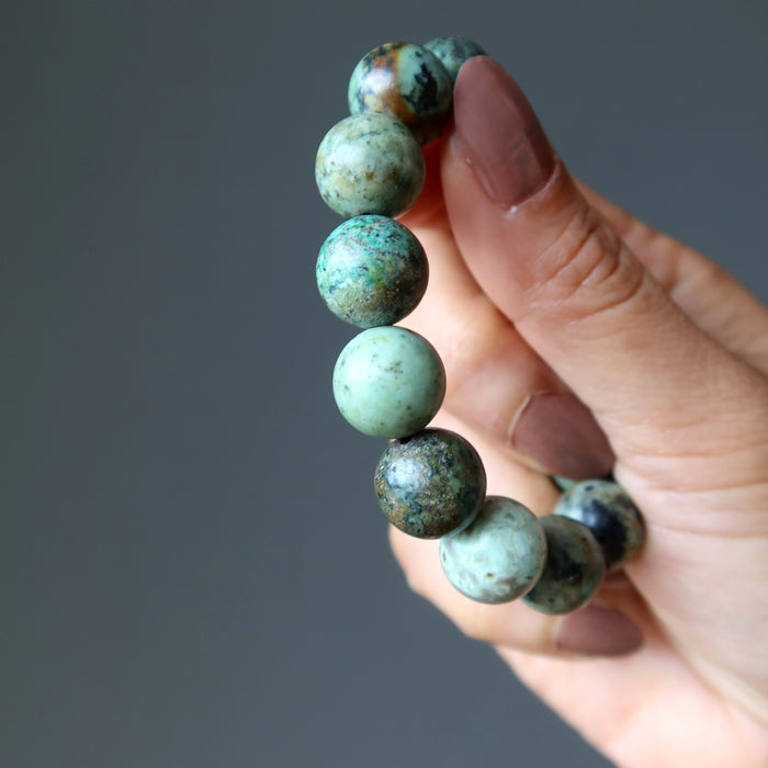 hand holding african turquoise bracelet