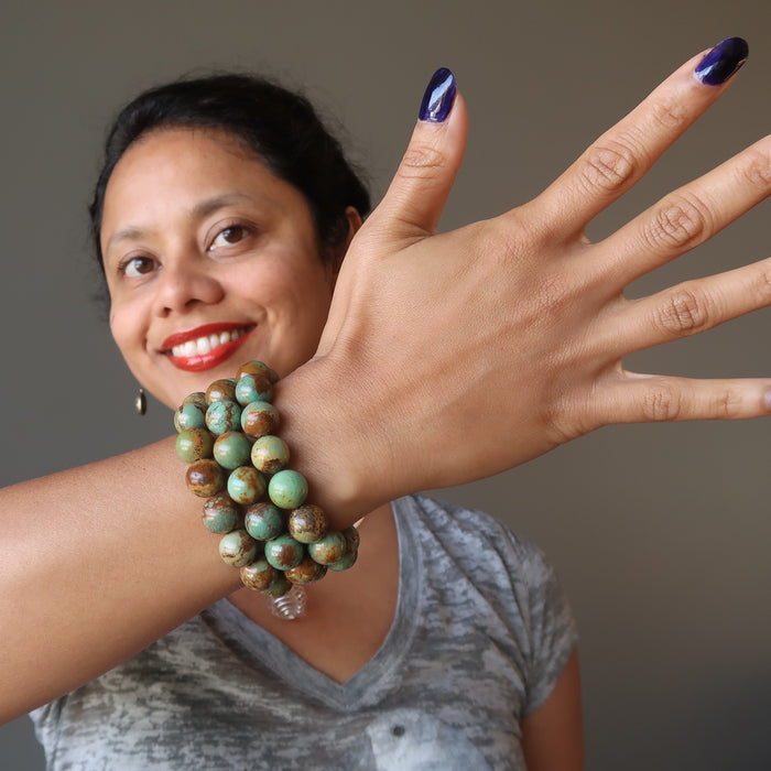 sheila of satin crystals wearing 3 green and brown turquoise jasper round beaded stretch bracelets