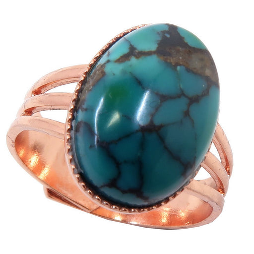 blue turquoise with black veins polished into an oval and set in a copper adjustable ring