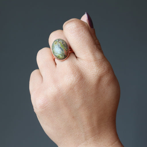 hand wearing unakite copper ring