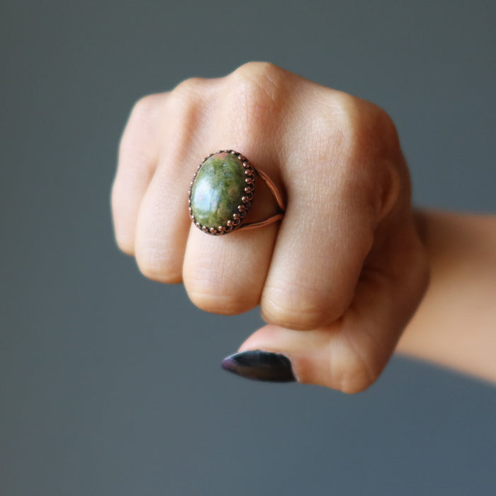 fist wearing unakite oval antique copper adjustable ring