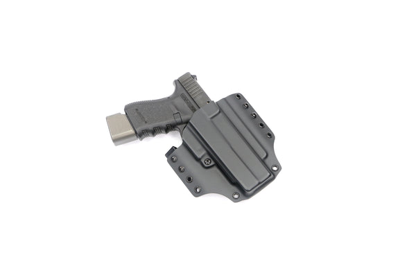 Holster for a Glock with a stand off device