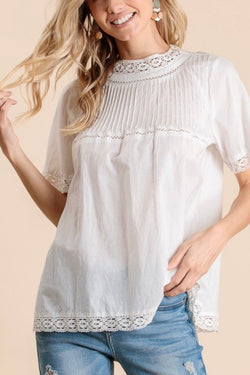 Cotton| short sleeve| mock neck| tunic| top| with pintuck| and lace| details