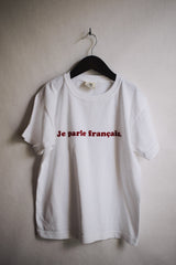 """I speak French."" Tee"