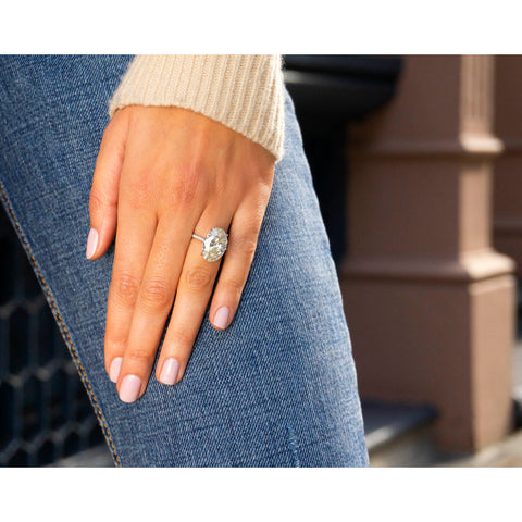 Oval Cut Solitaire Engagement Ring with Diamond Pavé