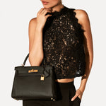 Kelly Retourne in Black by Hermès - Hermes