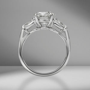 Round Brilliant Cut Engagement Ring with Pear Shape Side Stones