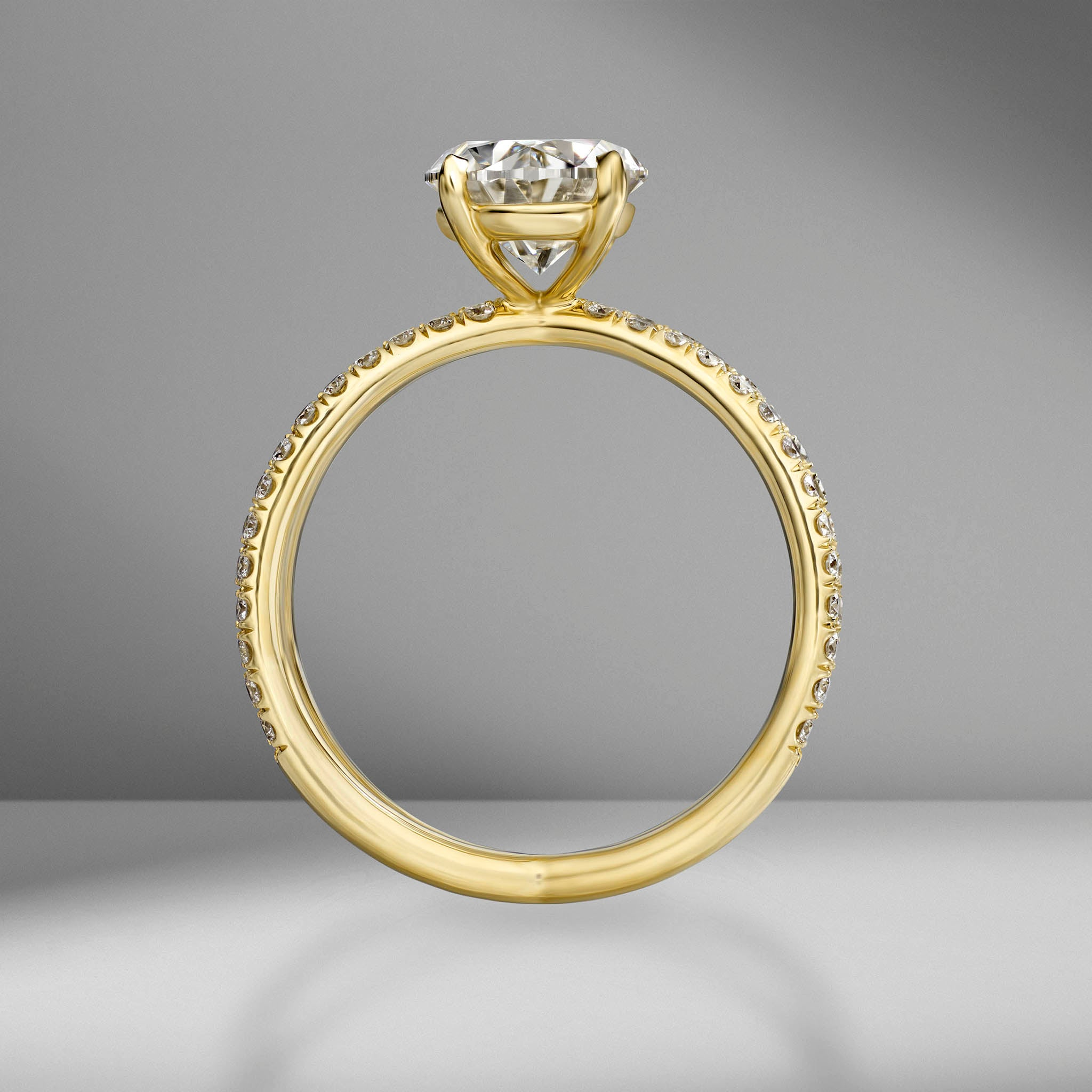 Oval Cut Engagement Ring with Pavé Reverse Split Shank Band
