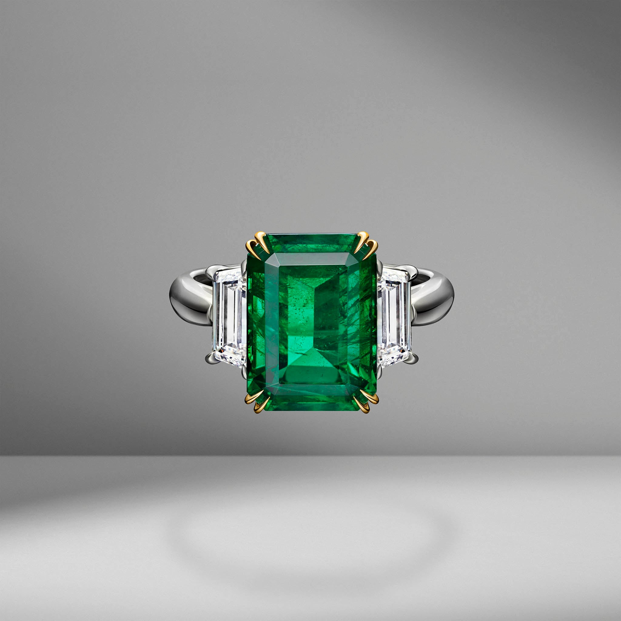 Emerald Ring Flanked with Trapezoid