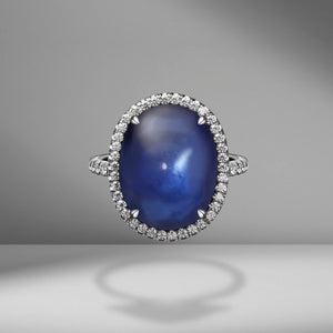 Oval Cabochon Sapphire Ring with diamond pavé