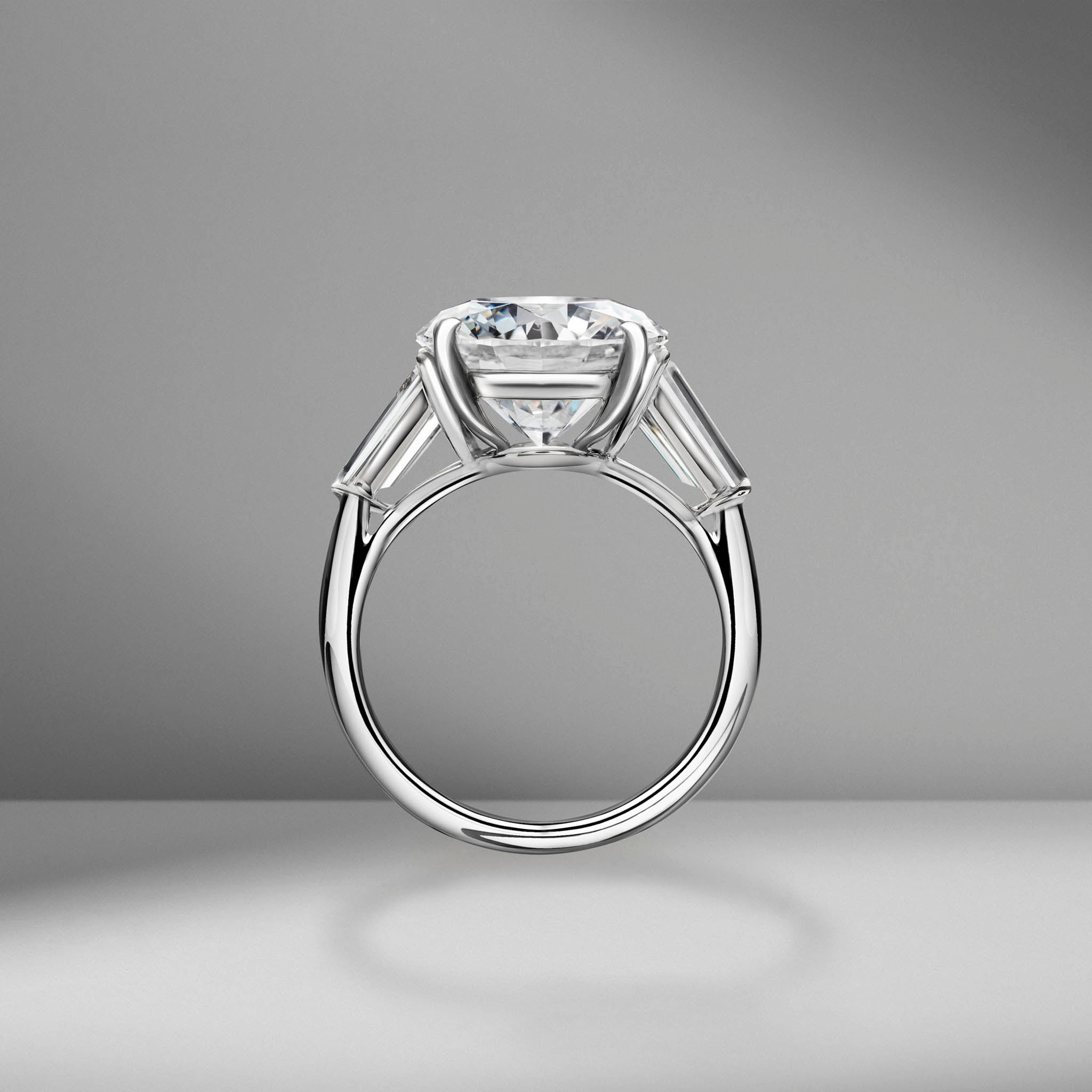 Round Brilliant Cut Engagement Ring with Tapered Baguettes