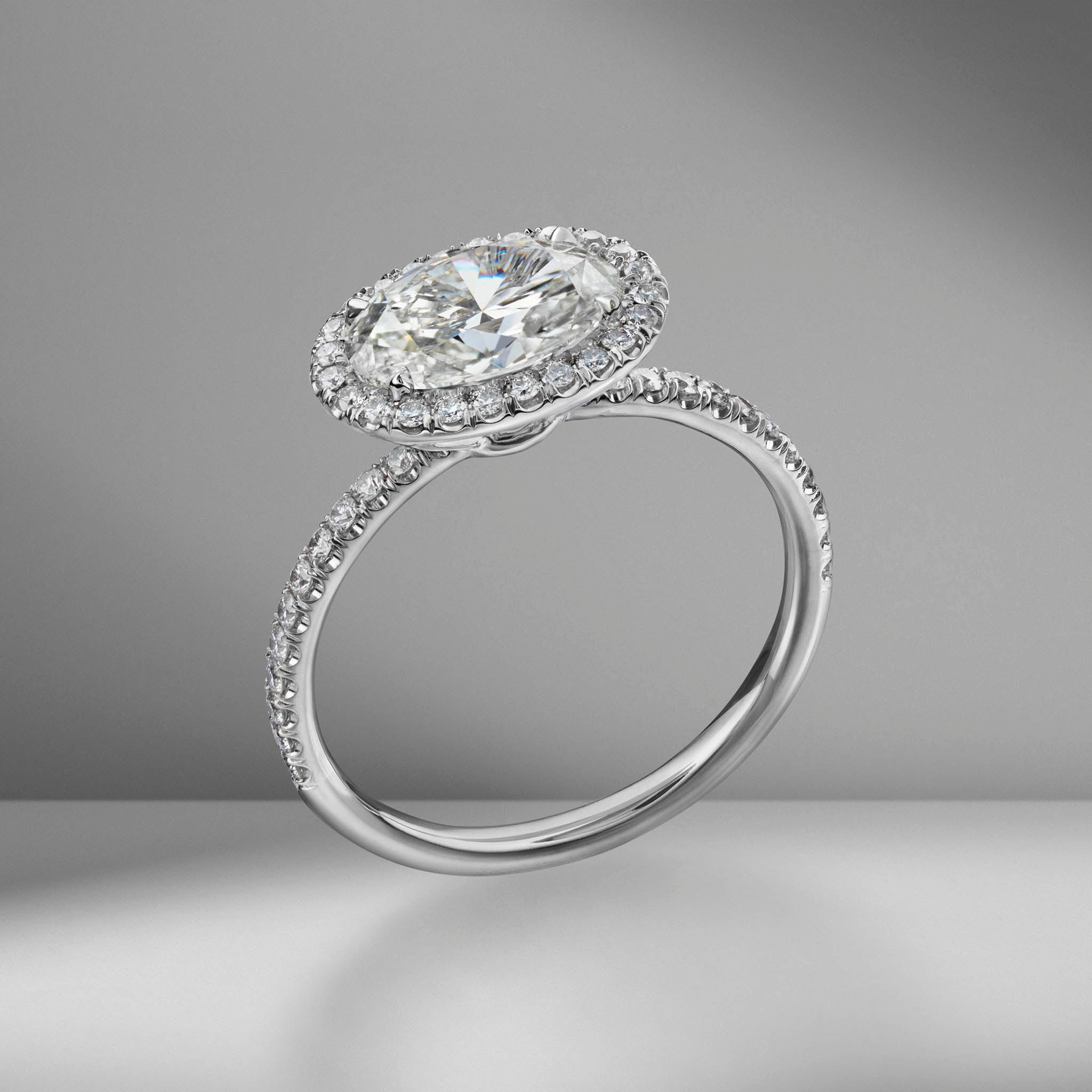 East-West Oval Cut Engagement Ring with Pavé Halo
