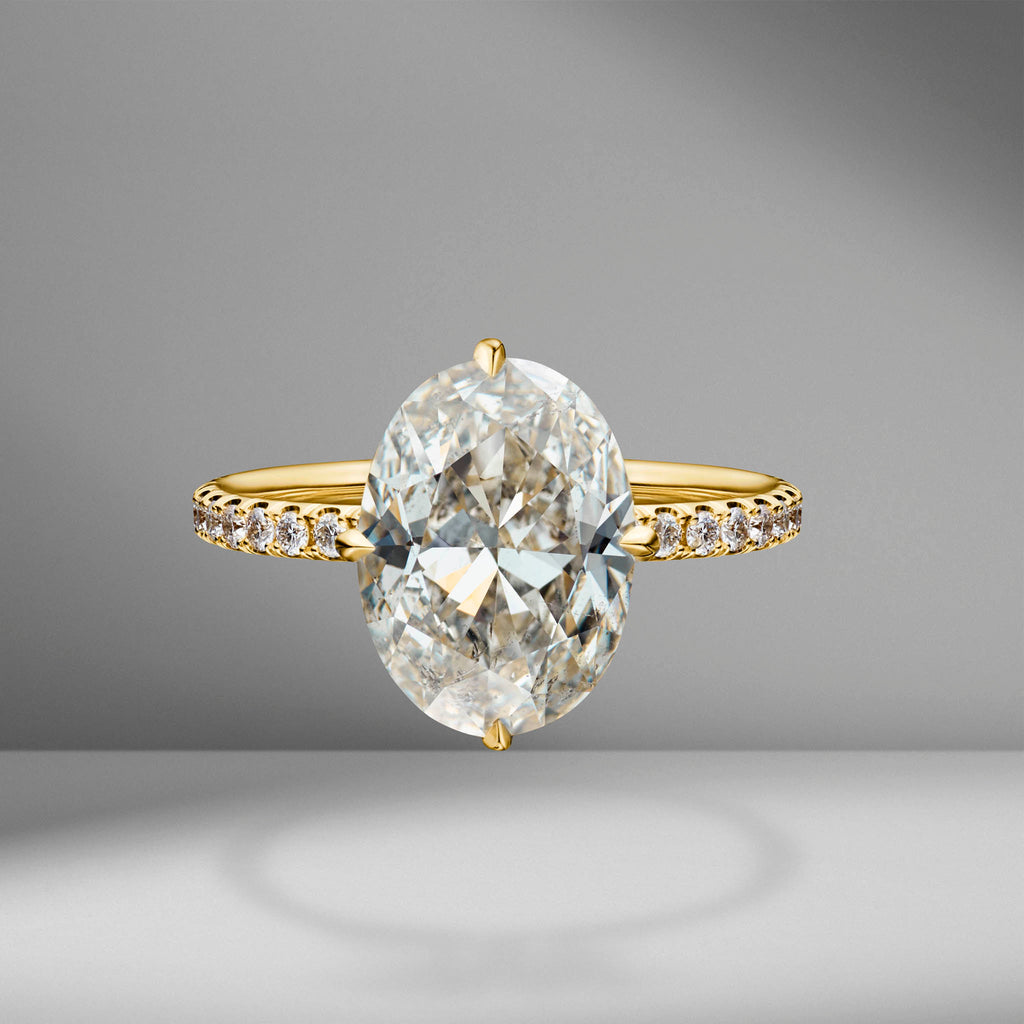 Compass Set Oval Cut Engagement Ring with Diamond Pavé
