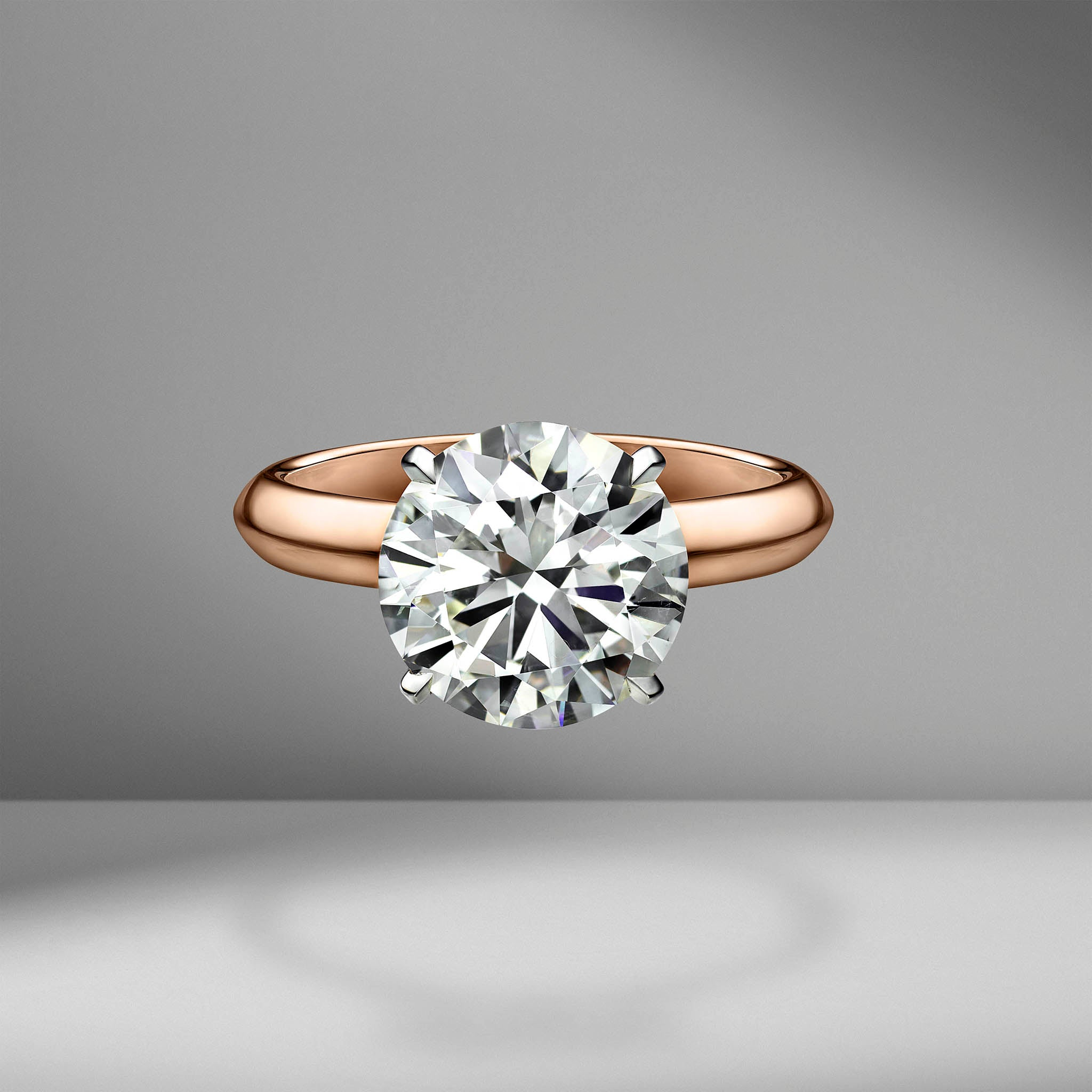 Round Brilliant Cut Solitaire Engagement Ring with Knife Edge Setting