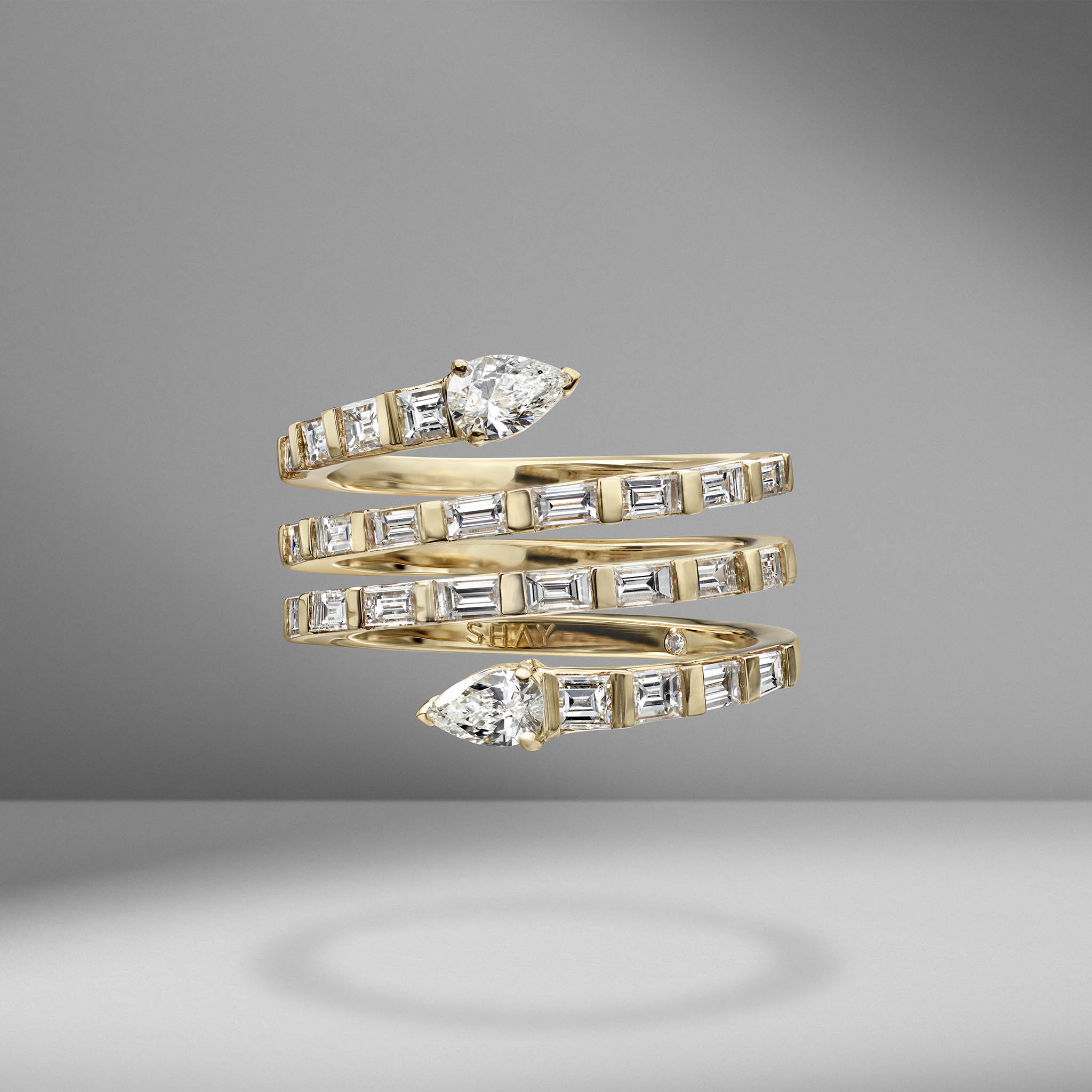 Pear Spiral Baguette Quad Ring