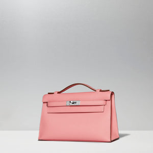 Kelly Pochette in Rose Confetti by Hermès