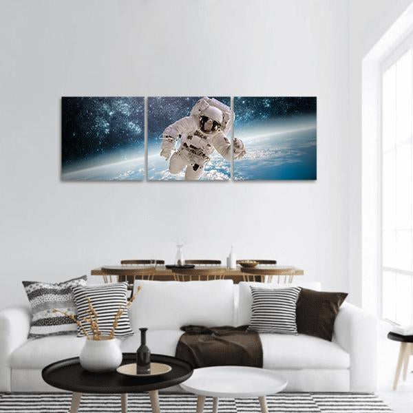 Astronaut In Outer Space Panoramic Canvas Wall Art 1 Piece / Small Tiaracle