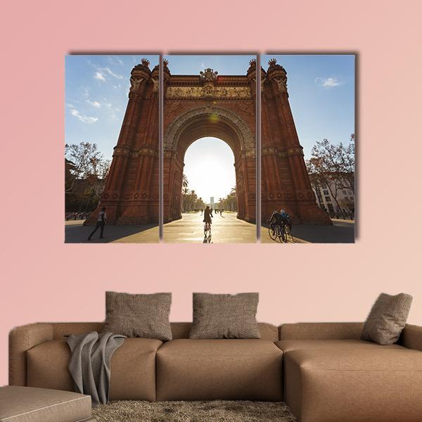 Cyclist Rides Into The Arc De Triomph Multi Panel Canvas Wall Art 4 Pieces / Medium / Canvas Tiaracle