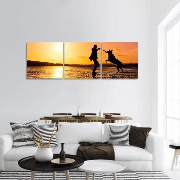 Girl Playing With Dog At A Beach Panoramic Canvas Wall Art Tiaracle