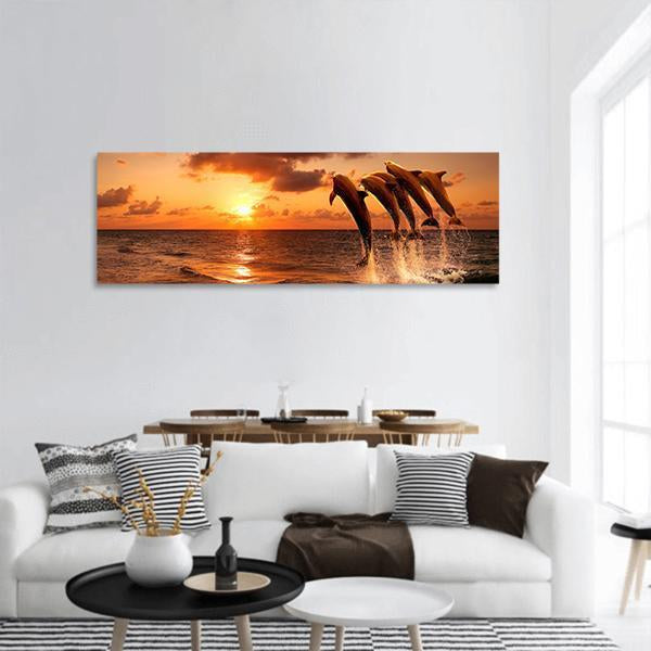 Sunset With Jumping Dolphins Panoramic Canvas Wall Art Tiaracle