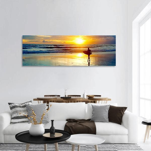 Surfer On Beach At Sunset In Indonesia Panoramic Canvas Wall Art 3 Piece / Small Tiaracle