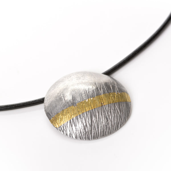 Textured oxidised silver, with a 24 carat gold stripe, choker. A wearable statement piece of jewellery