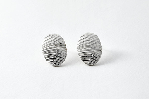 Oval striped textured silver stud earrings
