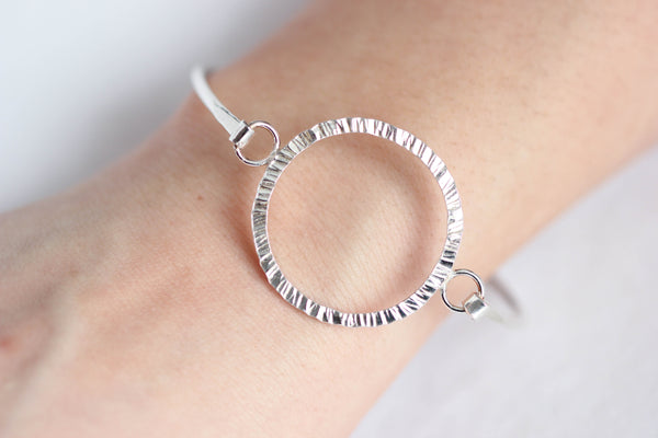 Textured circle, hooked bangle