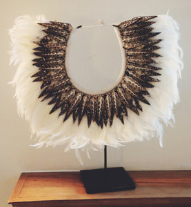 Shell-necklace with white feather