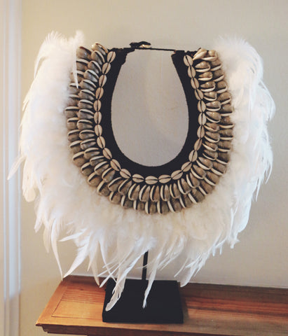 Shell necklace with white feather
