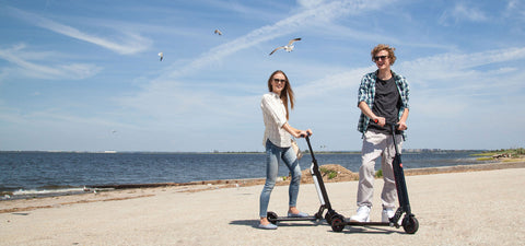 Two People Riding Electric Scooters