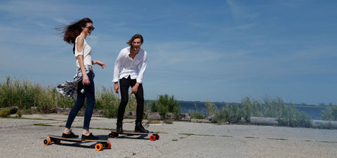 Two People Riding Electric Skateboards