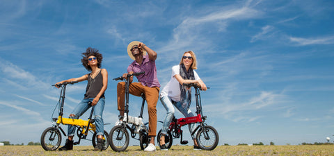 3 People Riding Electric Bikes by Genesis