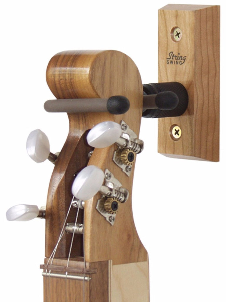 Wall hanger for scroll head dulcimer