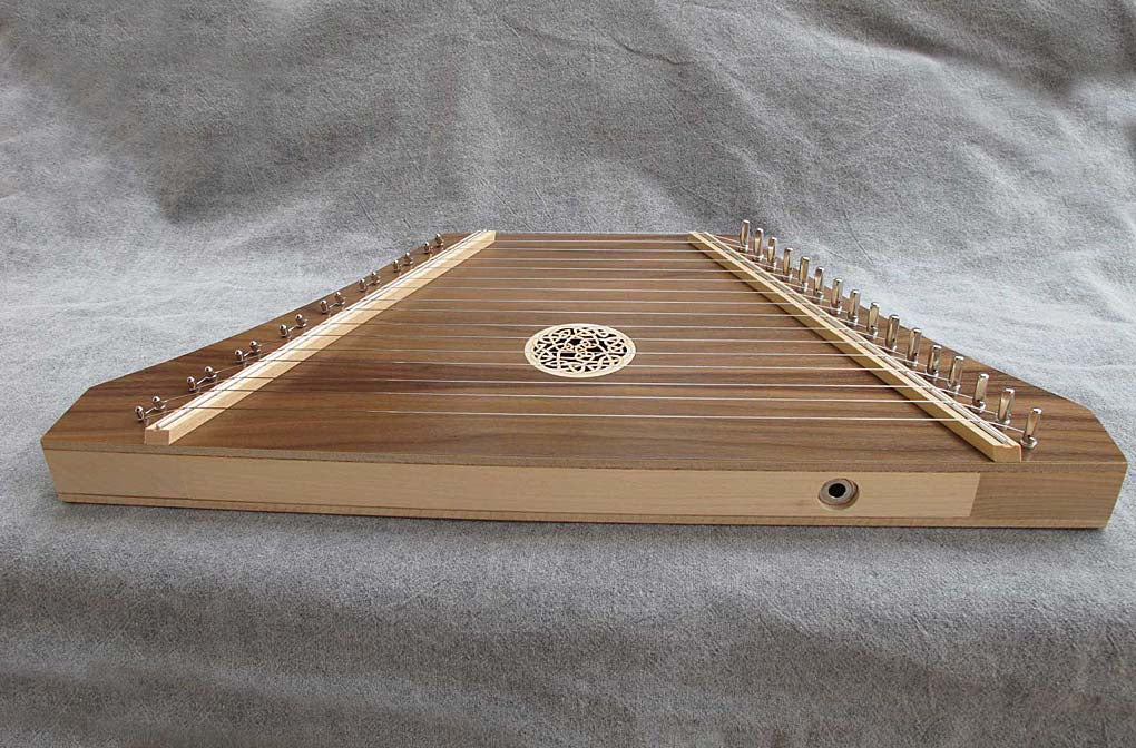 Custom Lap Harp in walnut with pickup on bottom rail.
