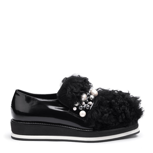 Shearling embellished glossed-leather platform sneakers