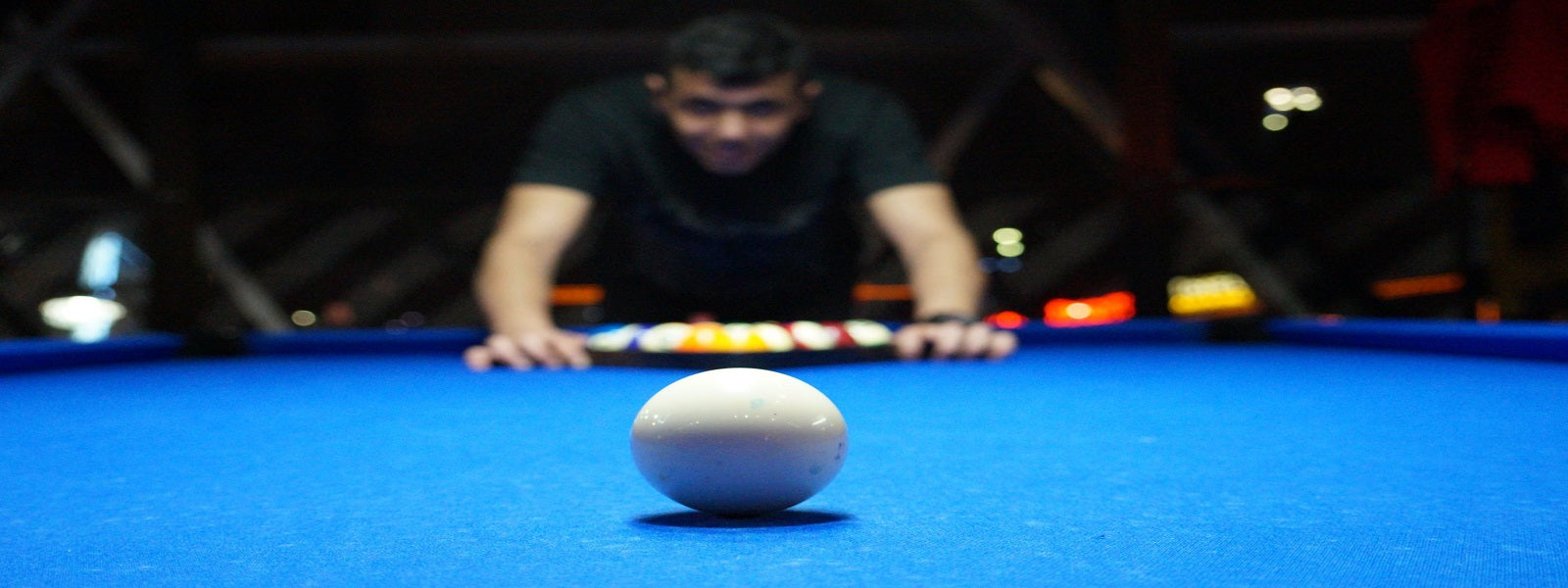 image of a pool player over table - absolute cues