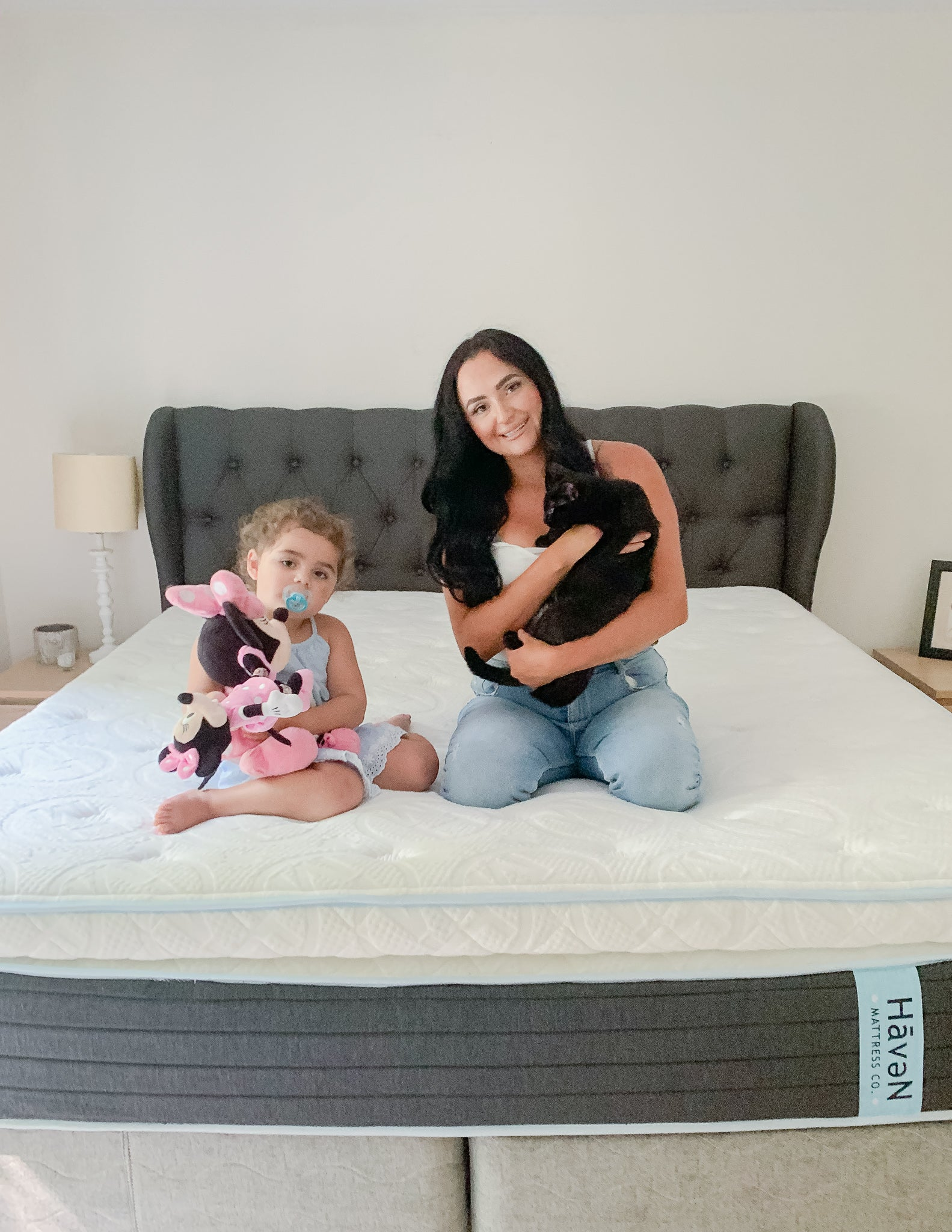 Stephanie Vainer and cat and daughter on haven mattress