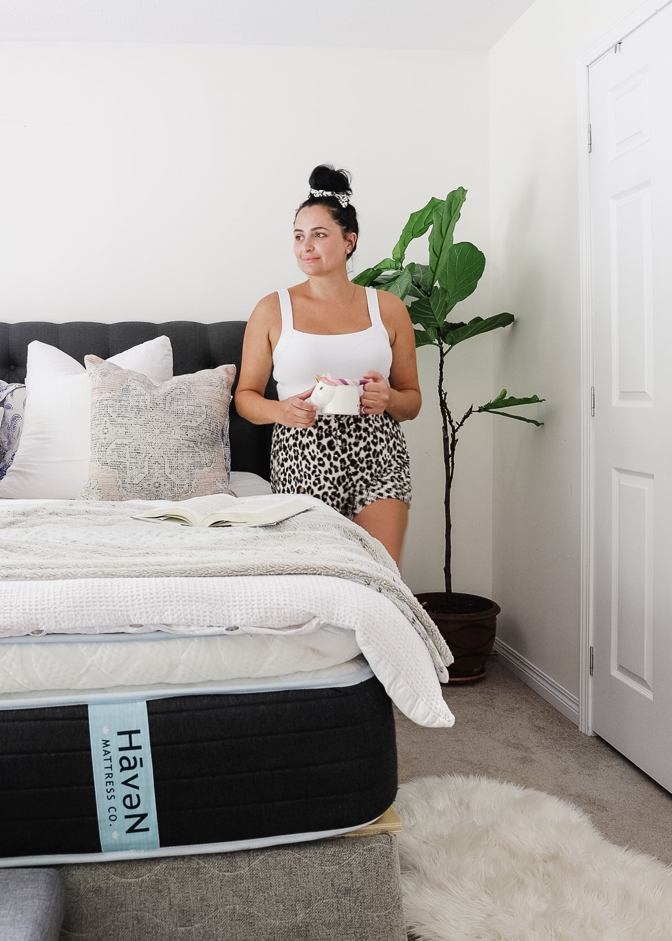 Stephanie Vainer SPV Living blogger and mom drinking in a mug by Haven mattress