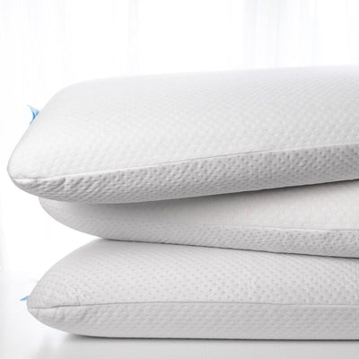 VitaGel 4-in-1 memory foam pillow using plant based materials stacked up in a pile of 3