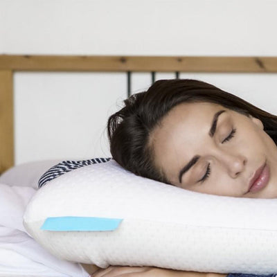 woman sleeping on a Bedface Vitagel 4 in 1 pillow with her hands tucked under the pillow