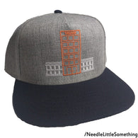 217bd49bbfa Needle Little Something. Regular price  15.35. TRUMP House Embroidered 5  Panel Heather Grey Navy Blue Cap-Already Embroidered-