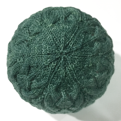 Crown of green knitted lace hat