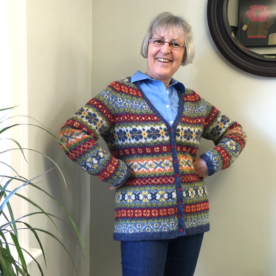 Janet Rice-Bredin of Pretty Warm Designs wearing her hand knitted Hedgerow sweater